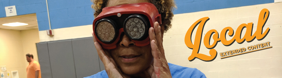 Staff experiencing clouded vision through a simulation device.