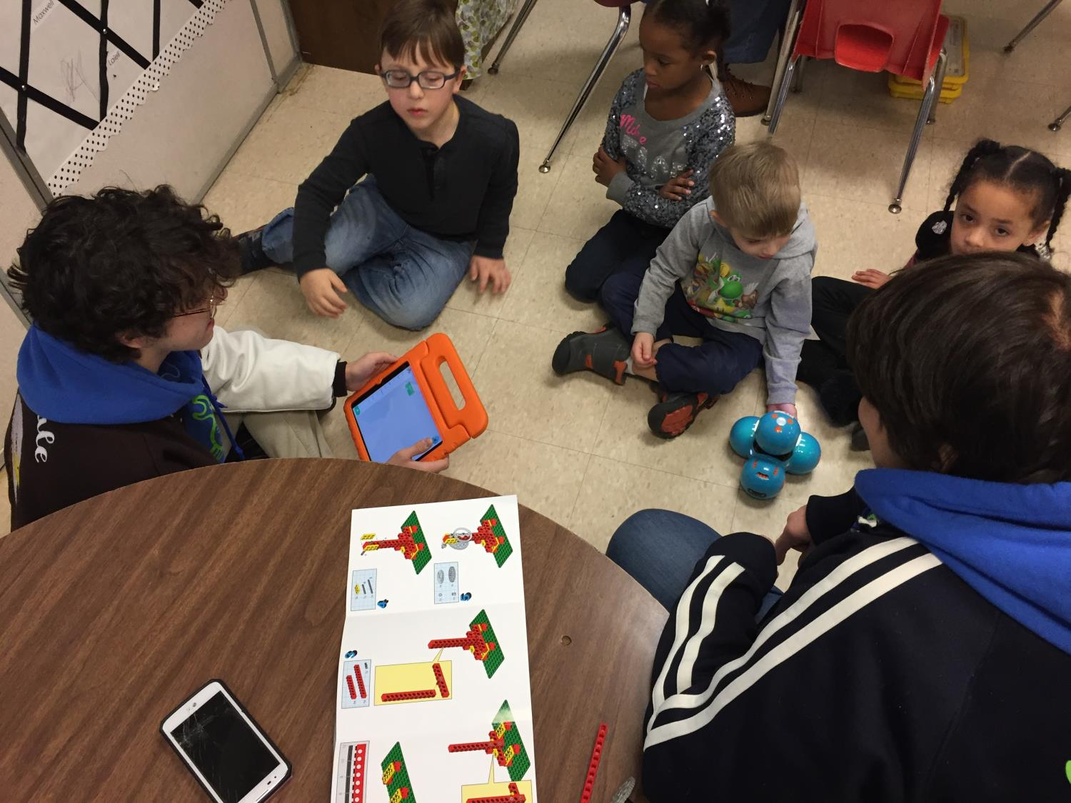 Kindergarten students build basic machines and practice coding.