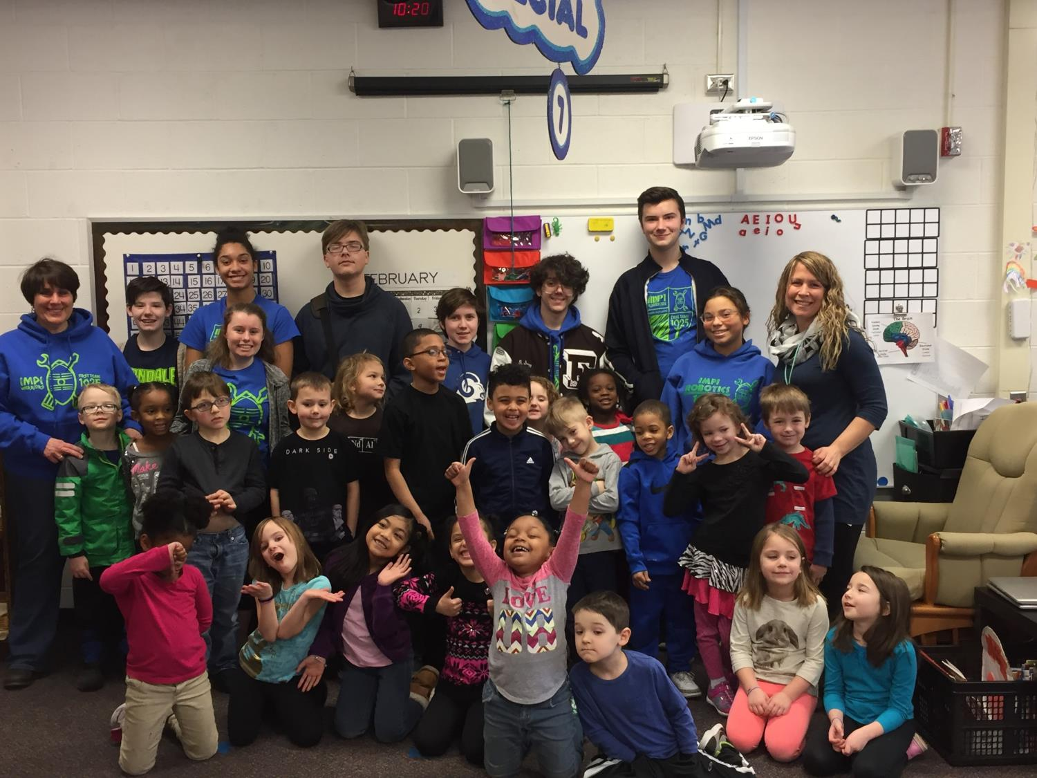 Impi Robotics team members stand with Ms. Pirronello's Kindergarten class after a day of coding fun.