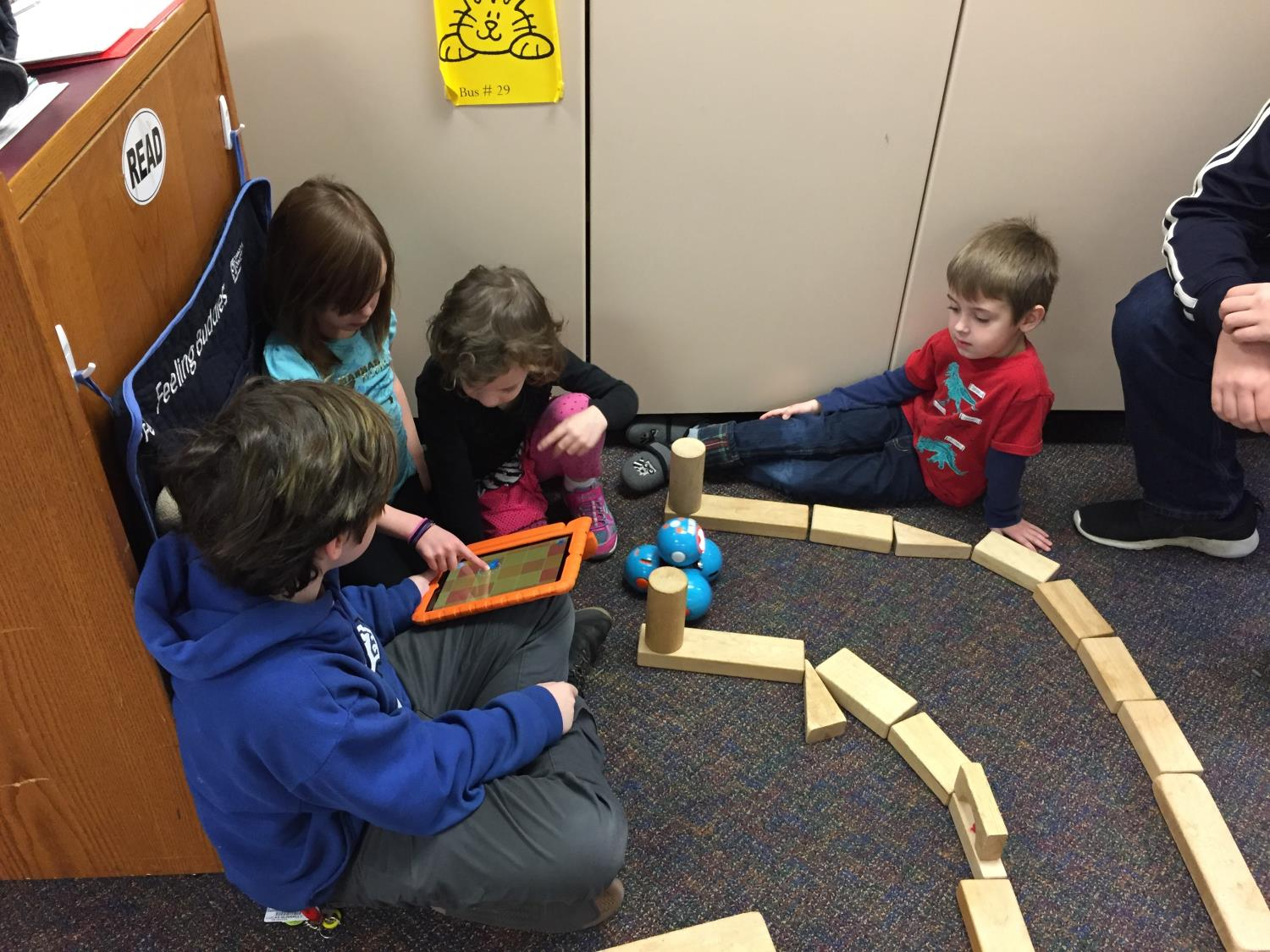 Kindergarteners built mazes and coded the robot to traverse through them.