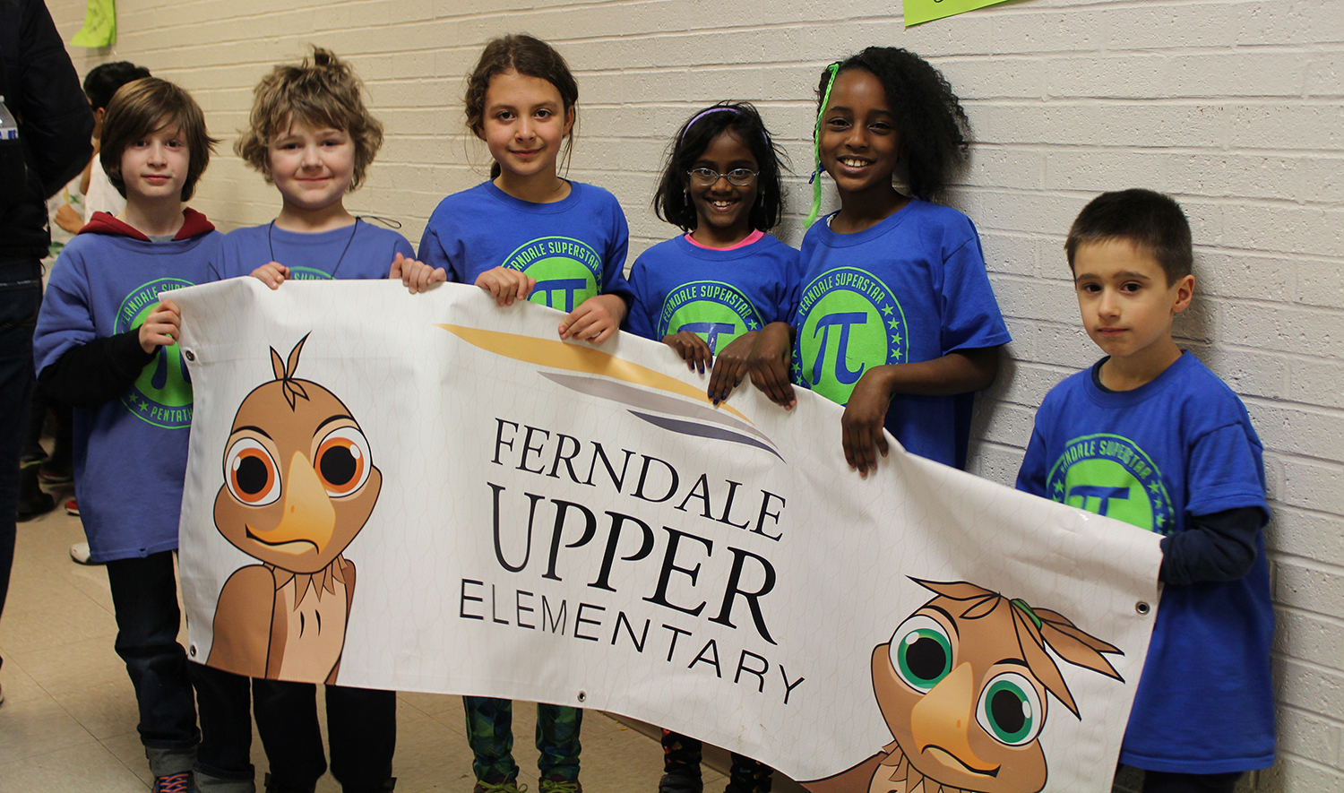 Elementary math pentathletes showing Ferndale Eagle pride with their school sign!